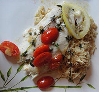Pangasius with cherry tomatoes and garlic